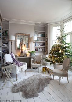 'A proper Christmas tree shouldreach right to the ceiling,' says Josephine.In the living room her signature style ofFrench and Gustavian furniture, painted floorboards and gilded decorations bring a wonderfully Christmassy feel to the room. The White Company (thewhitecompany.co.uk) sells similar sheepskin rugs