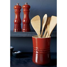 Shop Le Creuset ® Cerise Red Pepper Mill.  Le Creuset lends its signature color to the classic salt and pepper mills, crafted with modern technology to get the job done.  The mill's grinders adjust from fine to coarse with a turn of the knob.