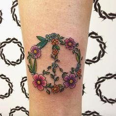 Floral peace sign by Effervescent Tattoo