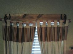 Easy rustic curtain rod. 1x6 piece of wood, horseshoes and tree limb.