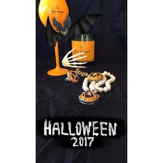 Wearing Memories jewellery celebrating Halloween with Veuve Clicquot champagne cap. #yelloween