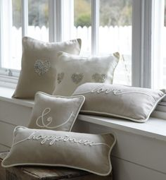 Beautiful cushions in pale linen cushion piped in ivory and hand decorated with 1 or 3 hearts made of mother of pearl buttons. Perfect!