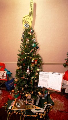 Green Bay Packers Tree Filled with Super Fan ornaments, a Donald Driver autographed banner, Clay Matthews doll and so much more. By Mike & Marianne Jarmuz and their Grandchildren Donald Driver, Leukemia And Lymphoma Society, Clay Matthews, How To Raise Money, Packers, Green Bay, Grandchildren, Banner, Trees