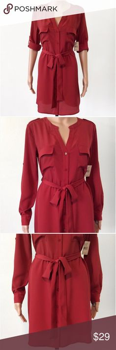 "Red Button Down Long Sleeve Shirt Dress Size Small New with tags! Rtl $79.  Non-stretch fabric.  Belt loops with same fabric belt included.  Roll-up sleeve option.  Two front breast pockets.  100% non-stretch polyester.   Measurements were taken with the dress laying flat:  33"" length, 20 1/4"" pit to pit, 19 3/4"" waist, 22"" bottom opening, 23 3/4"" pit to hem, 16"" shoulder to shoulder and 23"" sleeve. Multiply measurements by 2 where appropriate to get the full circumference where needed…"