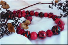 black and red polymer beads with crystals