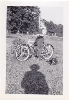 Has it all. French Bulldog, triumphant bike rider and the shadow of the photographer.