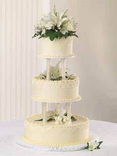 Cherish. Publix Wedding Cake. Graceful piping around the edges makes a nice contrast to the straight elegance of the columns on this cake.