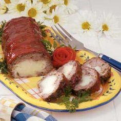 Meatloaf with mashed potatoes inside! Use one of our flavored mashed items for a little extra pizazz!