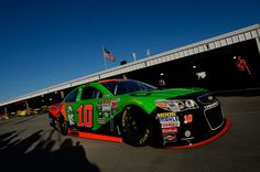 Danica Patrick drives the GoDaddy Chevrolet through the garage area during qualifying for the NASCAR Sprint Cup Series Goody's Headache Relief Shot...