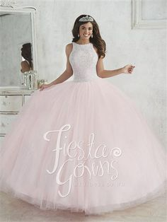 Fiesta Gowns 56318. A scoop halter neckline, fully beaded with pearls, rhinestones, sequins on the bodice. Gathered tulle ball gown skirt. Lace-up back.  #azaria #azariabridal #prom #quinceañera #fashion #love #lightgreen #likeforlike #followforfollow #heartforheart #ideal #promgoals #celebration #event #party #ballgown #princess #queen #dazzling #wow #achieve #sweetsixteen #eighteen #debut #perfect #fairytale