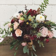 A lush and dark floral centrepiece.