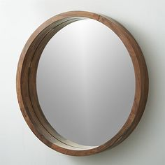 "acacia wood mirror  | CB2 24"" diameter, 3"" deep frame, $129,"