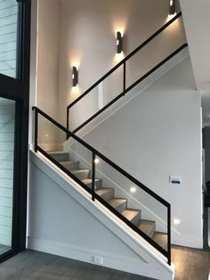 Steel and wooden staircases with a glass handrail lead to the second floor . - Steel and wooden stairs with a glass handrail lead to the second floor of this … – - Modern Stair Railing, Stair Railing Design, Home Stairs Design, Staircase Railings, Interior Stairs, Home Interior Design, Staircase Ideas, Railing Ideas, Staircase Remodel