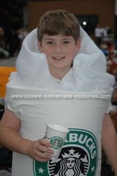 """Homemade Starbucks Coffee Cup Costume:Start by gluing together a large piece of 2"""" foam to make the cup. Cut out holes in the sides for arms.Then print out the graphics onto iron on transfer sheets and ironed them on to a large white sheet. Wrapped the foam in the sheet and added some batting around the top to look like foam."""