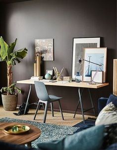 Create a work spot with a grown-up feel in a 'do it all' living room! IKEA offers a lot of living room furniture such as this dining table made with IKEA KARLBY worktop in birch and LERBERG trestles in grey.