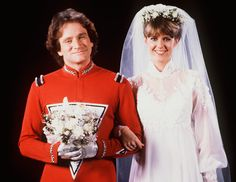 """Mork & Mindy """"The Wedding"""" Season Episode 2 Aired: Oct. 1981 Pictured: Mork played by Robin Williams and Mindy played by Pam Dawber. Robin Williams Death, Robin Williams Movies, Illuminati, Mork & Mindy, Cinema Tv, Wedding Movies, Wedding Stuff, Online Photo Gallery, Famous Couples"""
