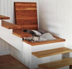 Great hidden storage for a landing on a staircase or in the floor.  Beautiful wood door!