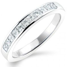 Platinum 1/2 Carat Princess cut Diamond half Eternity Ring 0.50ct Diamond half Eternity Ring F - G - Colour VS - Clarity Width of Ring 2.5mm This stunning half Eternity Ring features a single row of channel set Princess cut Diamonds. Ring width is 2.5mm Platinum 950 hallmarked and made in the United Kingdom Ring sizes J through to S... from NEWBURYSONLINE