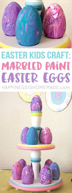These Marbled Easter Eggs are a quick and easy Easter kids craft that anyone can make! All it takes are wooden eggs, acrylic paint, and a baking pan!   via @hiHomemadeBlog