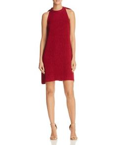 Elliatt Unwrapped Bow Halter Dress | Rayon/nylon; contrast: polyester/spandex; lining: polyester | Hand wash | Imported | Fits small, order one size up | Designed for a contemporary fit | Round halter