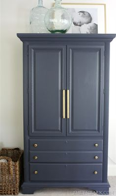 armoire makeover-hale navy by ben moore and beautiful satin brass handles.