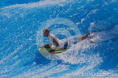 Photo about Rider body-boarding on the standing wave pool at Durbans Gateway. Image of photo, wavepool, outdoors - 29460282 Image Photography, Editorial Photography, Wave Pool, Waves, Outdoor Decor, Sports, Hs Sports, Ocean Waves, Sport