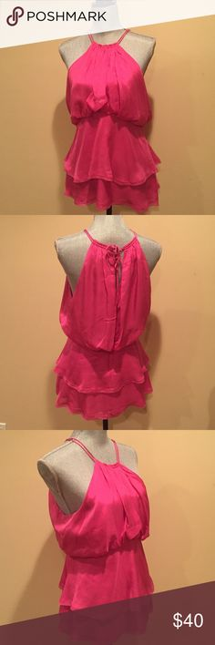 BCBGMAXAZRIA TOP Sexy and classic flowing halter style top. Wear it casually or dress it up! Tie in the back with small discreet opening, hook eye and zipper closure. Two flowing tiers in the bottom.  Shell 100% silk lining 100% polyester. Pictutes don't do this gorgeous top justice. BCBGMaxAzria Tops