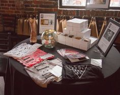 "NASHVILLE, TN - JULY 27: Raffle items from Annie Parker Jewelry and Graceful Rebel at VIE Magazine's ""Stories with Heart and Soul"" tour at The Listening Room Cafe to benefit Alaqua Animal Refuge. Photo by Rinn Garlanger"