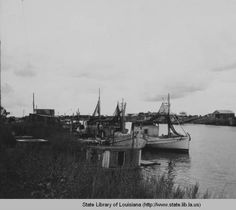 Drying nets on boats at Delacroix Island in Saint Bernard Parish Louisiana in 1930s :: State Library of Louisiana Historic Photograph Collection