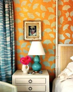 Orange wallpaper looks great against the turquoise blue and white...this is so mod. I love it