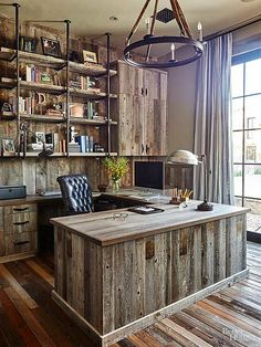 An all-wood home office brings barnyard-inspired chic to the next level. Contrasting shades and grains keep the office from looking too one-dimensional.