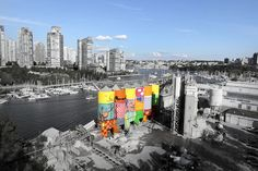 """The 'Giants' project, materialized by Brazilian street artists Os Gemeos, regards the twins paint 75 foot tall silos. Animated by the concept that """"every city needs art and art has to be in the middle of the people"""", the artists made pair with a non-profit public art organization Vancouver Biennale with the purpose to convert the Granville industrial landmark into a gigantic public art work. Take a look at the 360-degree art piece monuments below."""