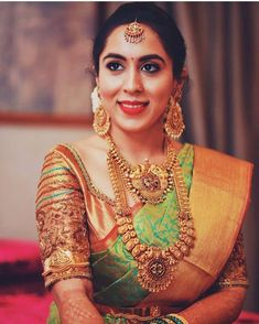 South Indian bride. Gold Indian bridal jewelry.Temple jewelry. Jhumkis. Green and gold silk kanchipuram sari. Braid with fresh jasmine flowers. Tamil bride. Telugu bride. Kannada bride. Hindu bride. Malayalee bride.Kerala bride.South Indian wedding. Pinterest: @deepa8
