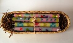 Hand poured and painted taper candles presented in gift basket sent with enclosure card.