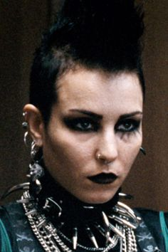 The Punk Provocateur: Noomi Rapace in The Girl Who Kicked the Hornet's Nest  The Beauty Mark: When trying to defend yourself against bogus murder charges, the smart thing to do would be to dress like a respectable member of society. Nothing doing for Rapace's Lisbeth Salander, who stomps into court sporting full goth/punk regalia in the Swedish film version of Stieg Larsson's second book in the Millennium trilogy. Rooney Mara, who?
