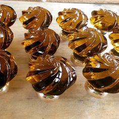 """Amber glass whirl cabinet knobs on brass #interiordesign #interiors #design #furniture #artisan #architect #glass"" Photo taken by @merlinglass on Instagram, pinned via the InstaPin iOS App! http://www.instapinapp.com (03/17/2015)"