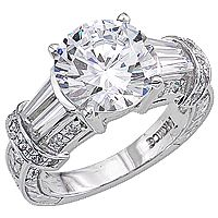 Karen Ring with Double Baguettes Estate Style CZ Ring... The Karen is a gorgeous estate style ring featuring a 3.0 carat round cubic zirconia center with two baguettes on each side, and accented by small round stones set into an intricate engraving design. Approximately 4.5 carats total weight. Available in 14K white gold or 14K yellow gold. Model: 6459R3, starting at $950.00