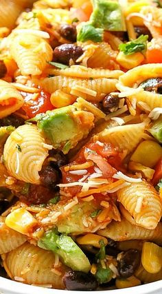 This Taco Pasta Salad is filled with black beans, corn, cilantro, avocados, and tomatoes. It's also tossed in a vinaigrette and sprinkled with cheese.