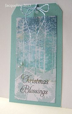 """By Jacqueline de Groot. Hero Arts """"Winter Trees"""" (negative image stamp) inked with a gradation of blue ink then stamped onto patterned paper. Soft like a snowfall."""
