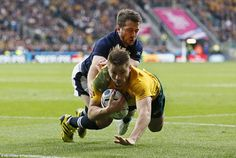 Australia's versatile back Drew Mitchell goes over for the first of two tries against Scotland in the World Cup quarter-final at Twickenham