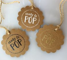 Set of 20 hand embossed Ready to POP baby shower favor tags. Attach to a bag of popcorn, a container of popcorn kernels, a pack of bubble gum, a lollipop, or a cake pop for your special guests. Each tag is hand punched from high quality sturdy card paper and hand embossed with the phrase Ready to POP and a customized detail (either a circular border of dots or popping motion lines on either side of the phrase). The tags are then hand strung with natural twine. These tags arrive ready to…