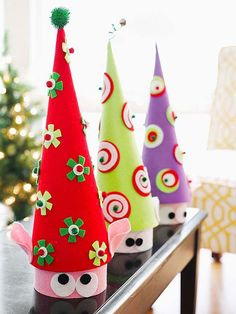 Turn inexpensive papier-mí¢ché boxes and cones into an eye-catching place to store wrapped holiday treats.