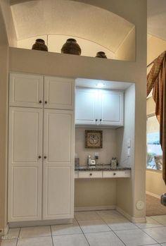 Kitchen remodeling ideas: take a large pantry and cut in half.  Half small pantry and Half small kitchen desk.