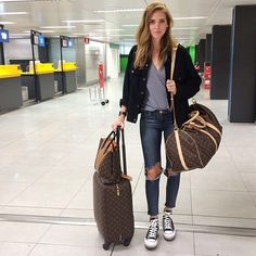 how to rock an airport: louis vuitton, platform converse sneakers, ripped jeans, black denim jacket and grey loose tee
