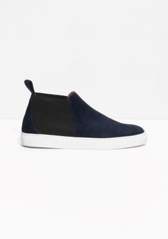 Comfy slip-on sneakers featuring a diverse clean-cut look, crafted from luxe goat suede.