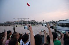 "People take pictures of a flag ceremony at the Tiananmen square - China's symbolic political heart - prior to the 27th anniversary of what some people refer to as the ""June 4 massacre, in Beijing on June 4, 2016, China. In April 1989, tens of thousands of Chinese activists demanding political reform and freedom of expression, gathered in Tiananmen Square. The large-scale protests had started April 15, with all sectors of society taking part. On June 4, however, the mood changed dramatically…"