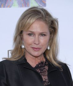 Kathy Hilton wore dangling pearls with her lacy LBD for a totally classy look. #celebrity #jewelry