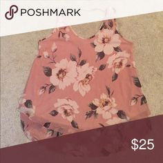 Blush sleeveless tank with floral detail Brand new without tags. never worn. from a smoke free home. String Detail at the top it goes across the back shoulders. MTS Tops Tank Tops
