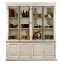 Salvaged from French chateaus, these unique windows and doors set the scene for one-of-a-kind cabinetry and storage!  #kathykuohome #FrenchCountryDecor