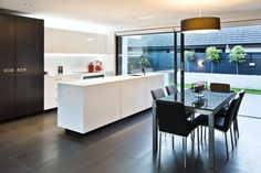 Bold and modern kitchen design in Manawatu Showhome. Featuring lacquered cabinetry and a Silestone benchtop, with under cabinet lighting to illuminate bench space. While Basalt tiles stretch underfoot. Under Cabinet Lighting, Kit Homes, Modern Kitchen Design, Fences, Tiles, Kitchens, House Design, Space, Top